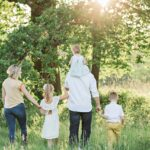 Family walking amongst trees